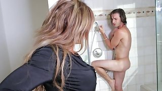 Mommy attacks the big cock while in the shower